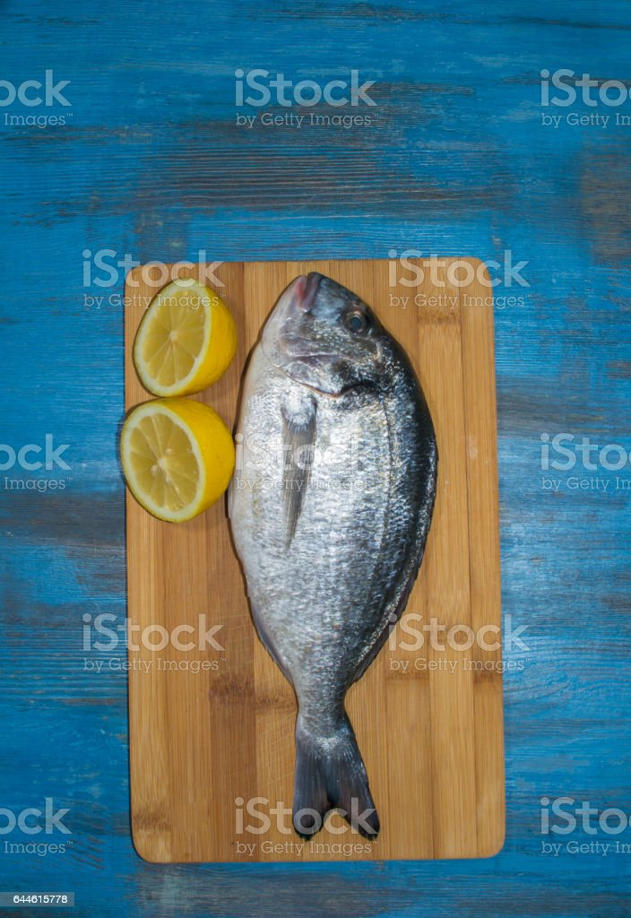 fish delicacy on wooden stock photo