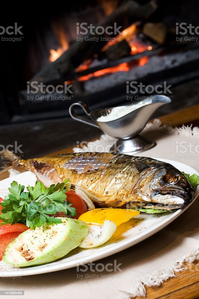 fish dinner on a plate royalty-free stock photo