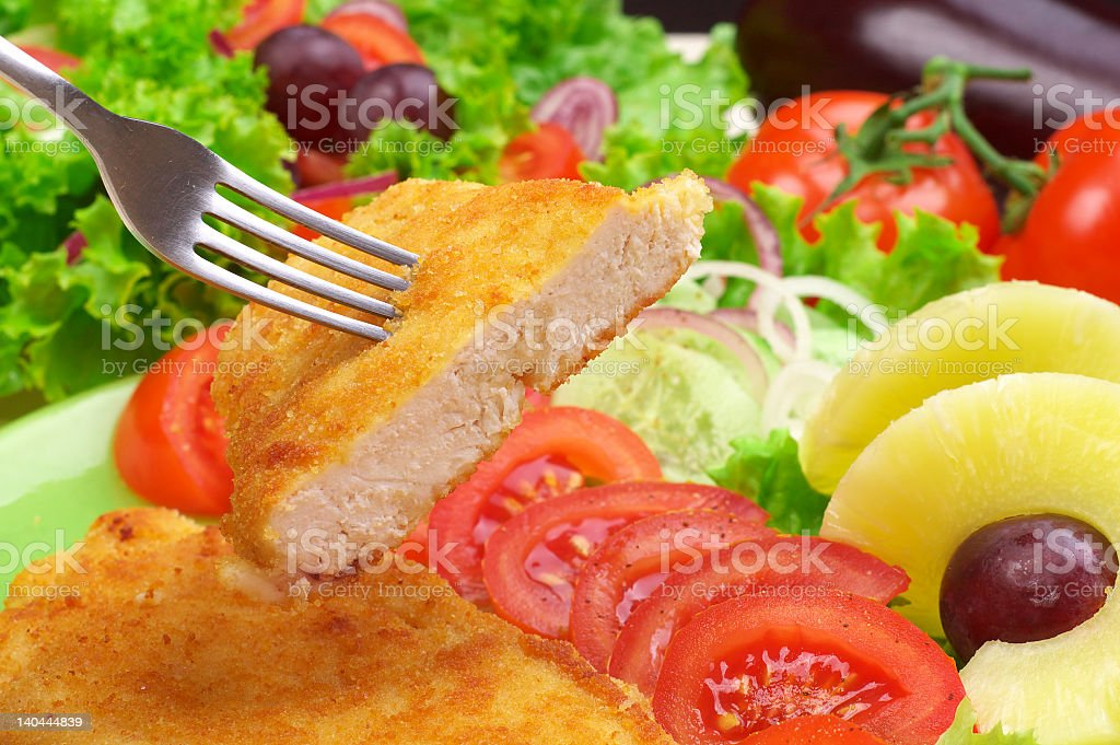 Fish dinner with a large salad and fruit stock photo