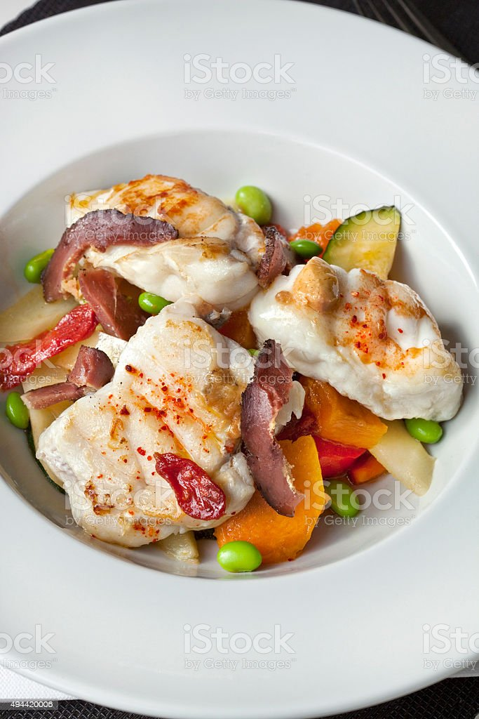 Fish dish and vegetable stock photo