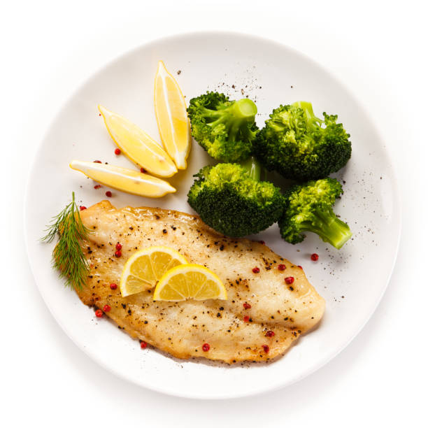 Fish dish - fish fillet and vegetables stock photo