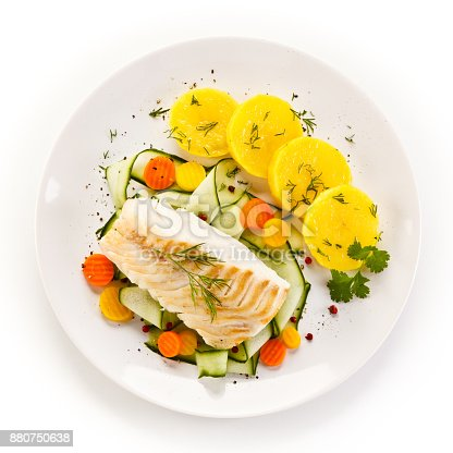 istock Fish dish - fried fish fillet and vegetables 880750638