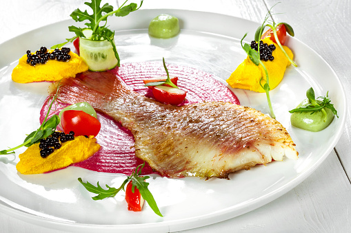 istock Fish dish - fried fish fillet and vegetables 892457864