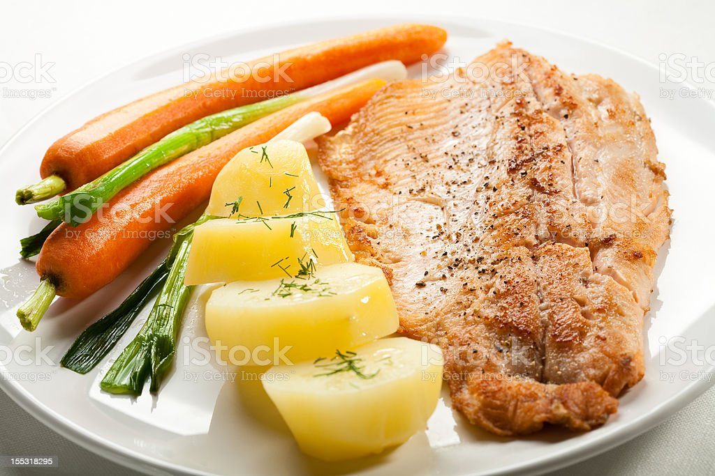 Fish dish - fried trout royalty-free stock photo