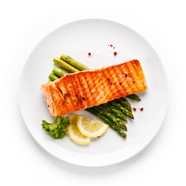 Fish dish - grilled salmon and asparagus Fish dish - roast salmon directly above stock pictures, royalty-free photos & images