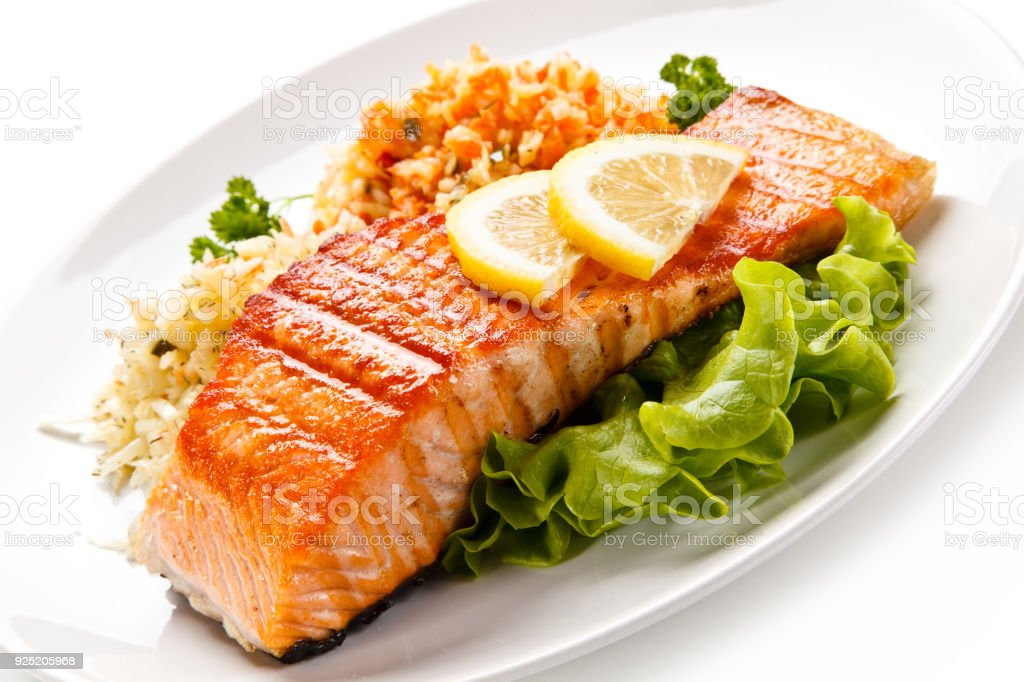 Fish dish - grilled salmon and vegetable salad stock photo