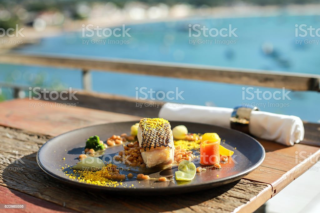 Fish dish in front of Brazilian ocean view stock photo