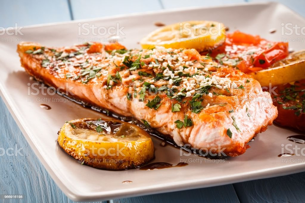 Fish dish - salmon steak and vegetables stock photo