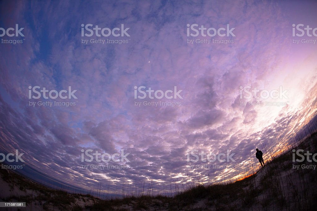 Fish Eye perspective of man standing on coastal shoreline royalty-free stock photo