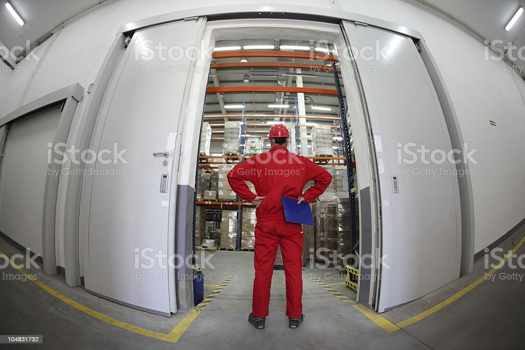 A fish eye view of a man with challenges in a warehouse royalty-free stock photo