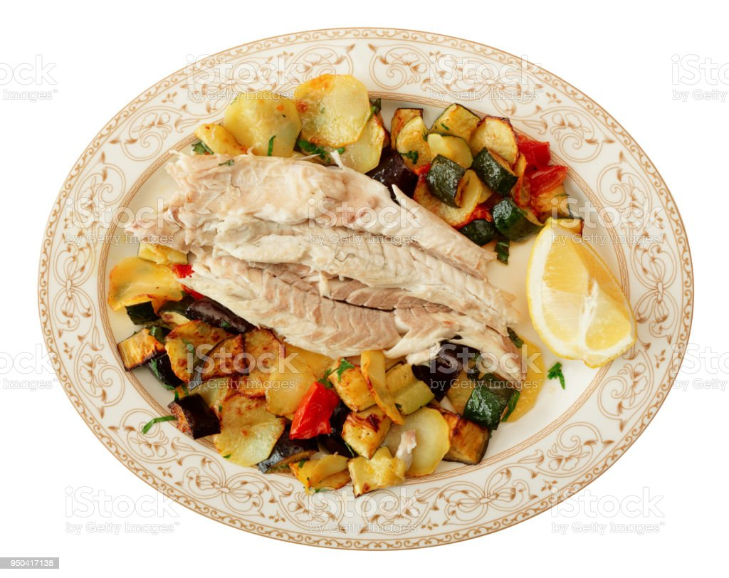 Fish fillet baked with vegetables isolated on white stock photo