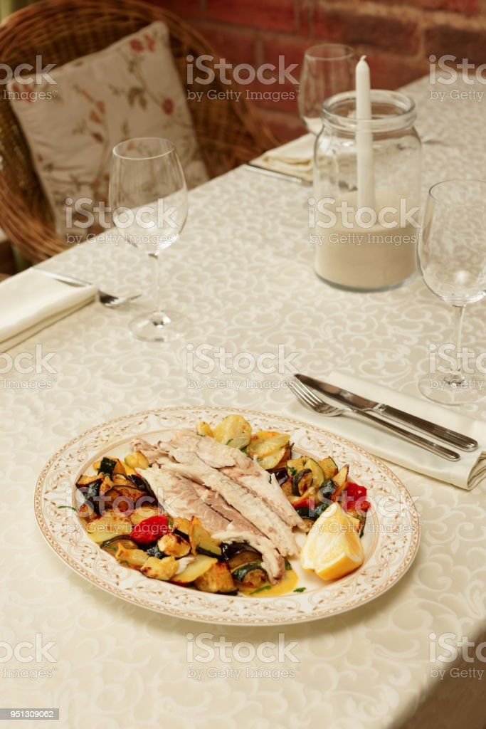 Fish fillet baked with vegetables stock photo