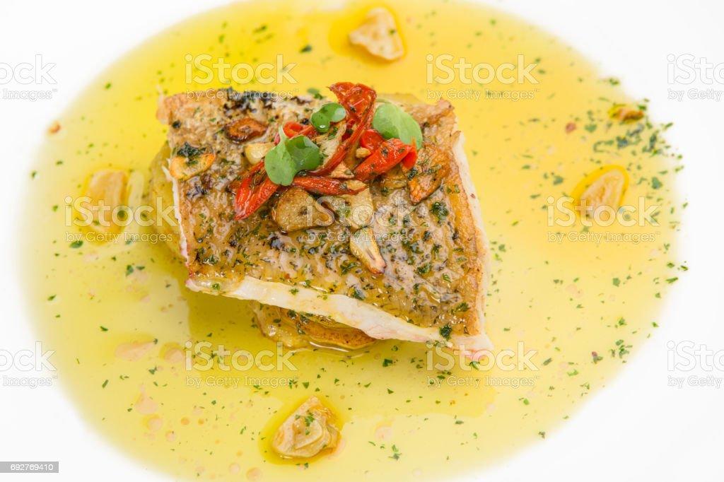 Fish fillet in butter lemon sauce stock photo