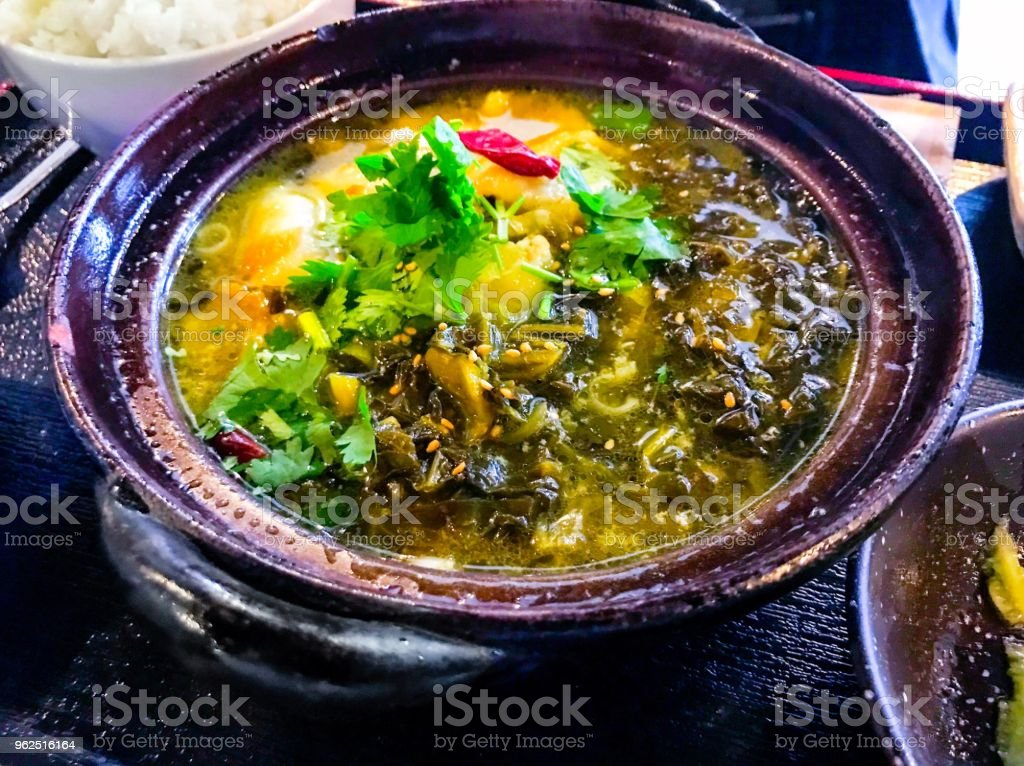 Fish fillet stewed with pickled leaf mustard - Royalty-free Bowl Stock Photo