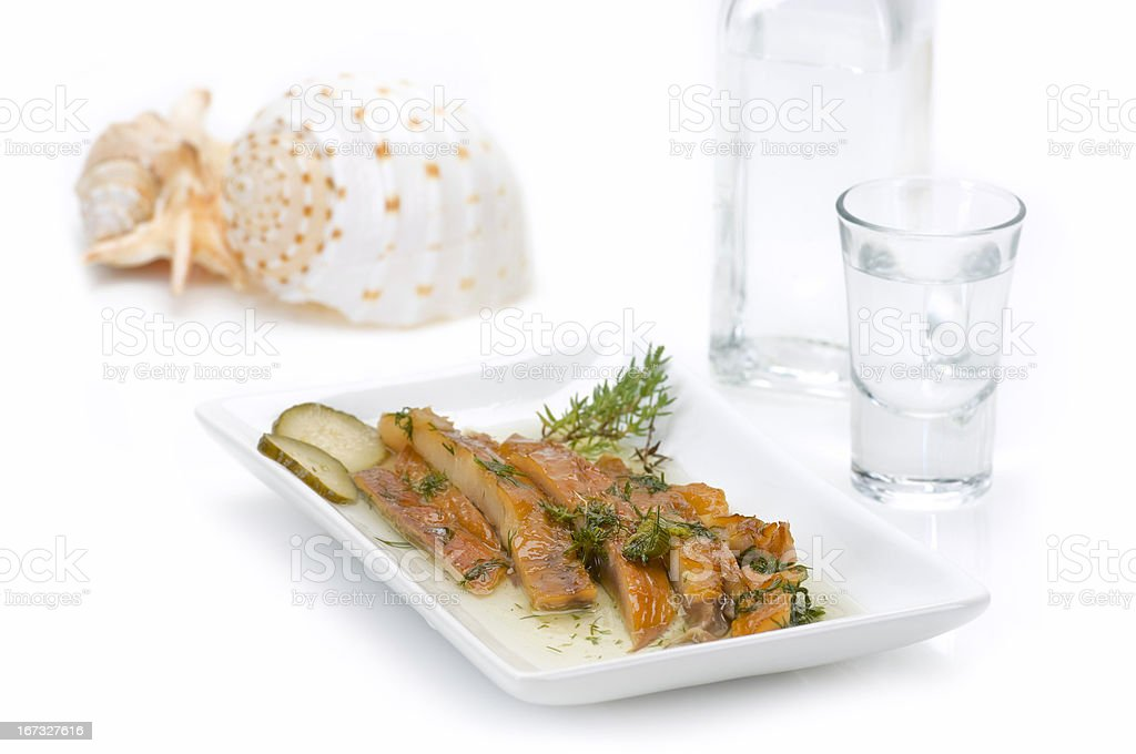 fish fillet(sun dried)and ouzo royalty-free stock photo