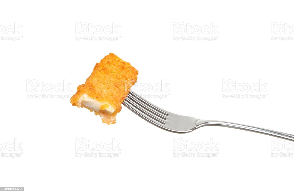 Fish finger on a fork stock photo