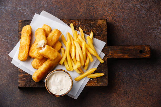 Fish fingers and Chips with tartar sauce stock photo