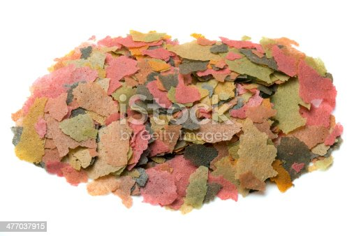 A pile of pet fish food flakes.