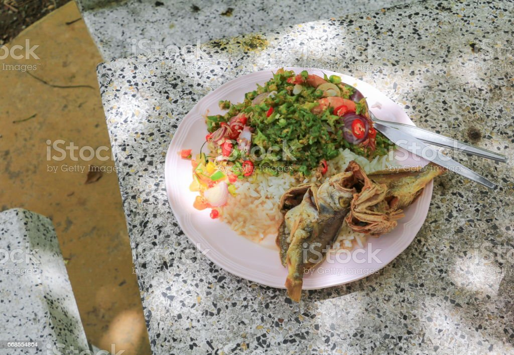 Fish fried and winged bean in rice plate Thai food countryside stock photo