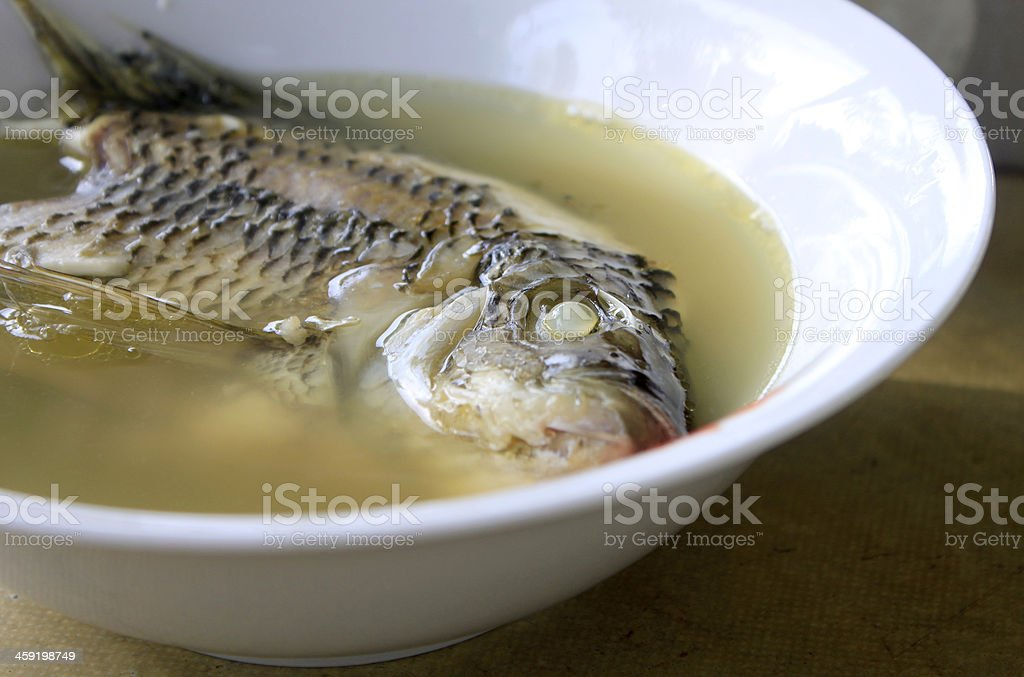Fish head soup in a bowl stock photo