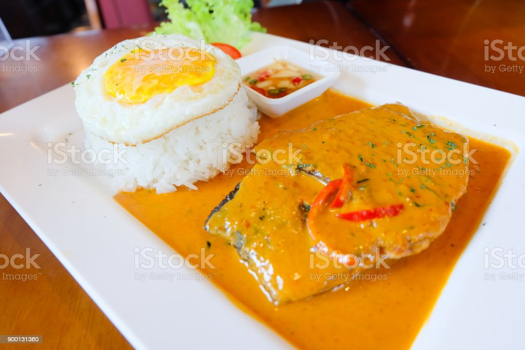 Fish in dried red curry served with egg and rice, Thai food stock photo