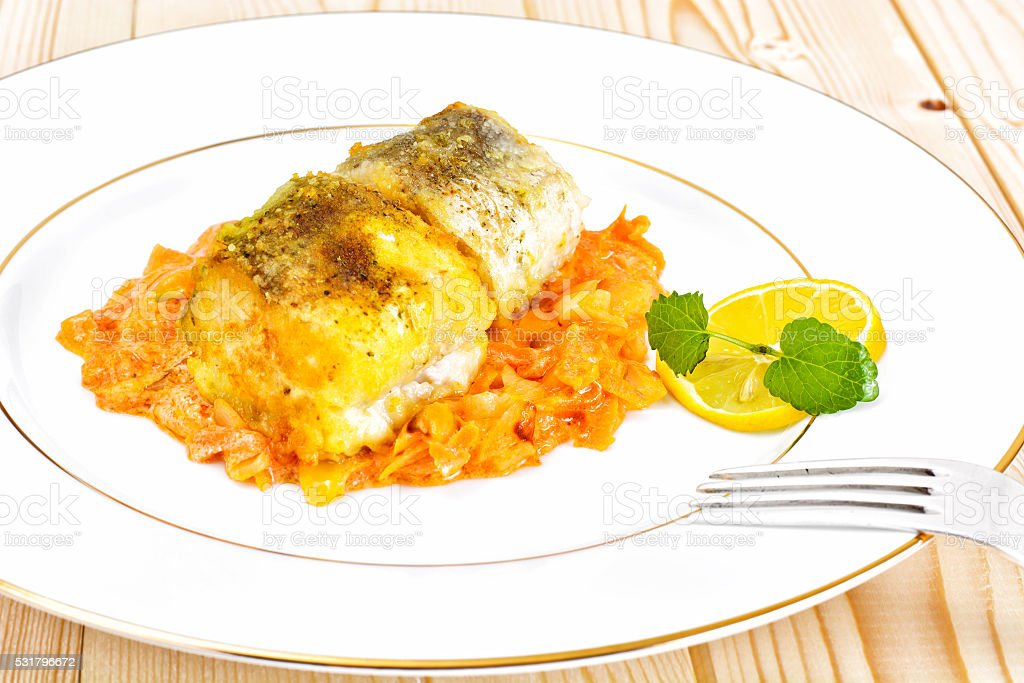 Fish in Greek with Onion and Carrot stock photo