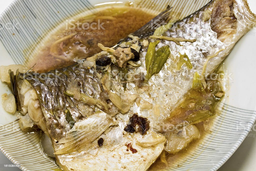 Fish in soy sauce royalty-free stock photo