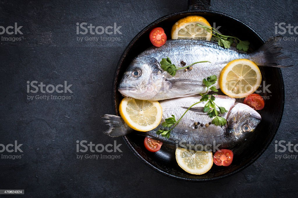 Fish in the pan stock photo