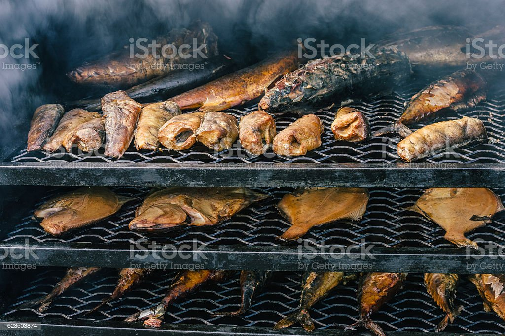 Fish in the smoking oven. stock photo