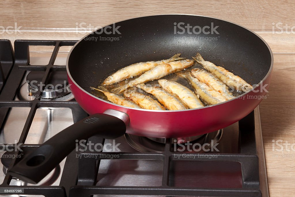 Fish is fried in a pan stock photo