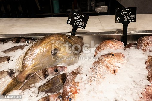 Fish: John Dory and snapper on ice for sale in the fish market.