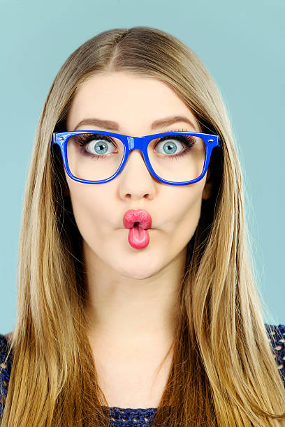 fish lips teenager having funny expression, wearing nerd eyeglasses. grimacing stock pictures, royalty-free photos & images