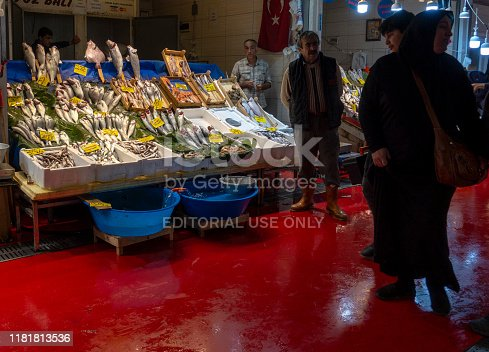 Istanbul, Turkey - October 17, 2019: Fresh Fish for sale on Istanbul Street, Turkey. Vendors are talking at the entrance while waiting for customers