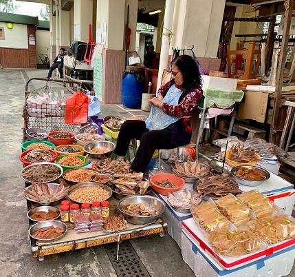 Tai O, Hong Kong - January 18, 2020: Fish monger is presenting their products at Tai O seafood market.