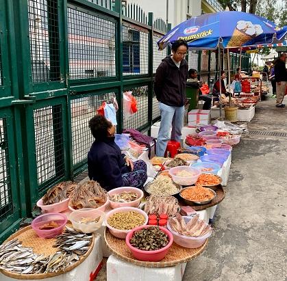 Tai O, Hong Kong - January 18, 2020: Fish mongers are presenting their products at Tai O seafood market.