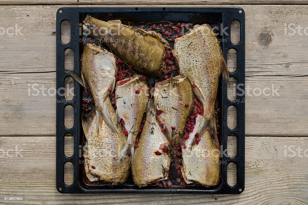 Fish Meat on a Black Tray stock photo