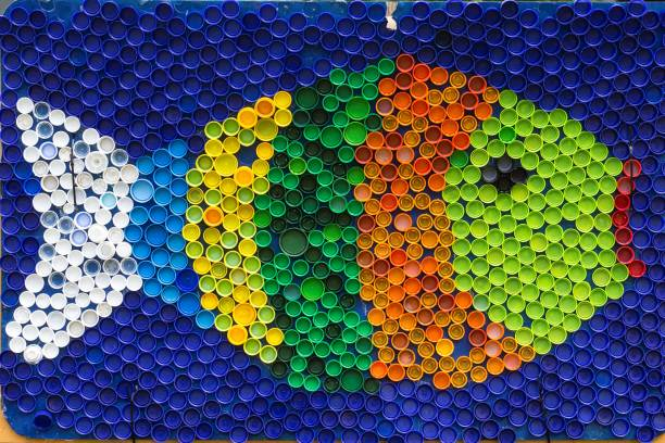 fish mosaic deocoration made of cororful plastic bottle caps . summer season and travel concept. handmade crafts. recycling art. - plastic cap stock pictures, royalty-free photos & images