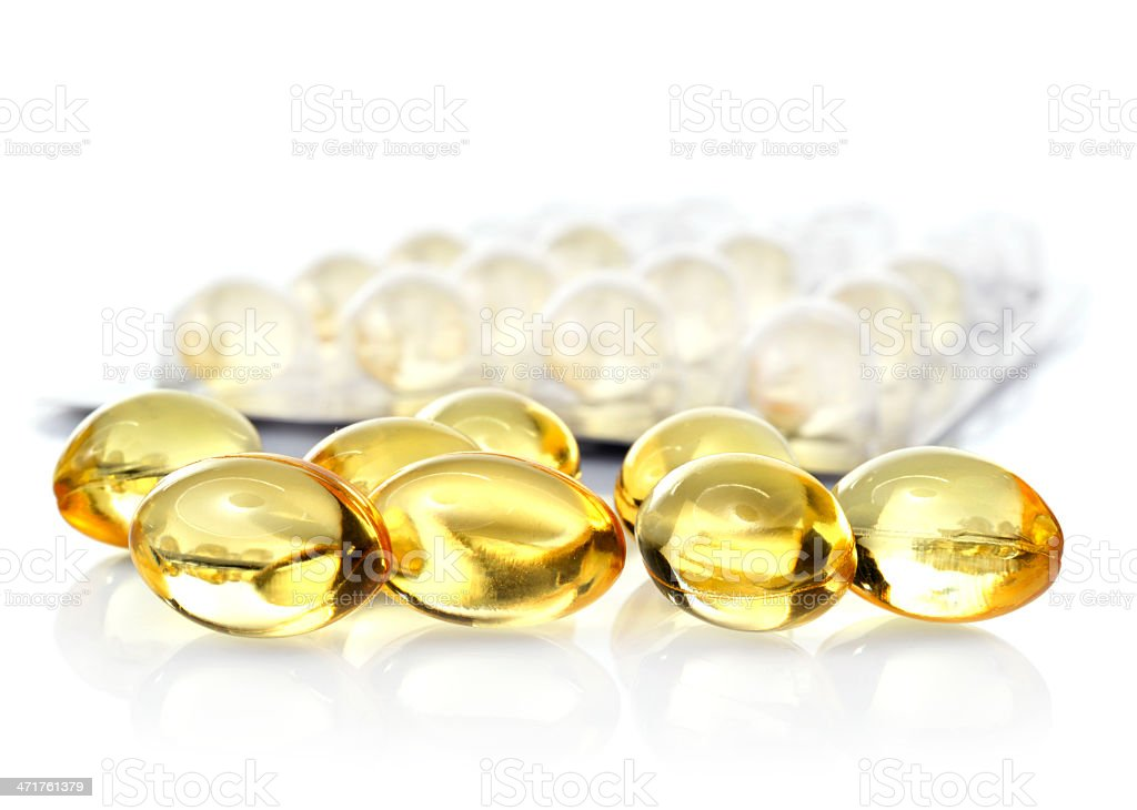fish oil capsules and blister pack isolated on white background royalty-free stock photo