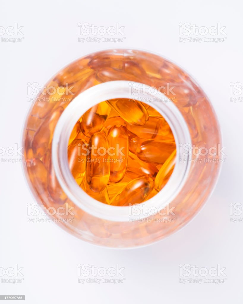 Fish oil capsules in bottle royalty-free stock photo