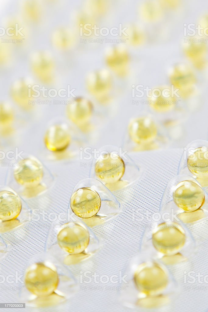 fish oil capsules in the package royalty-free stock photo