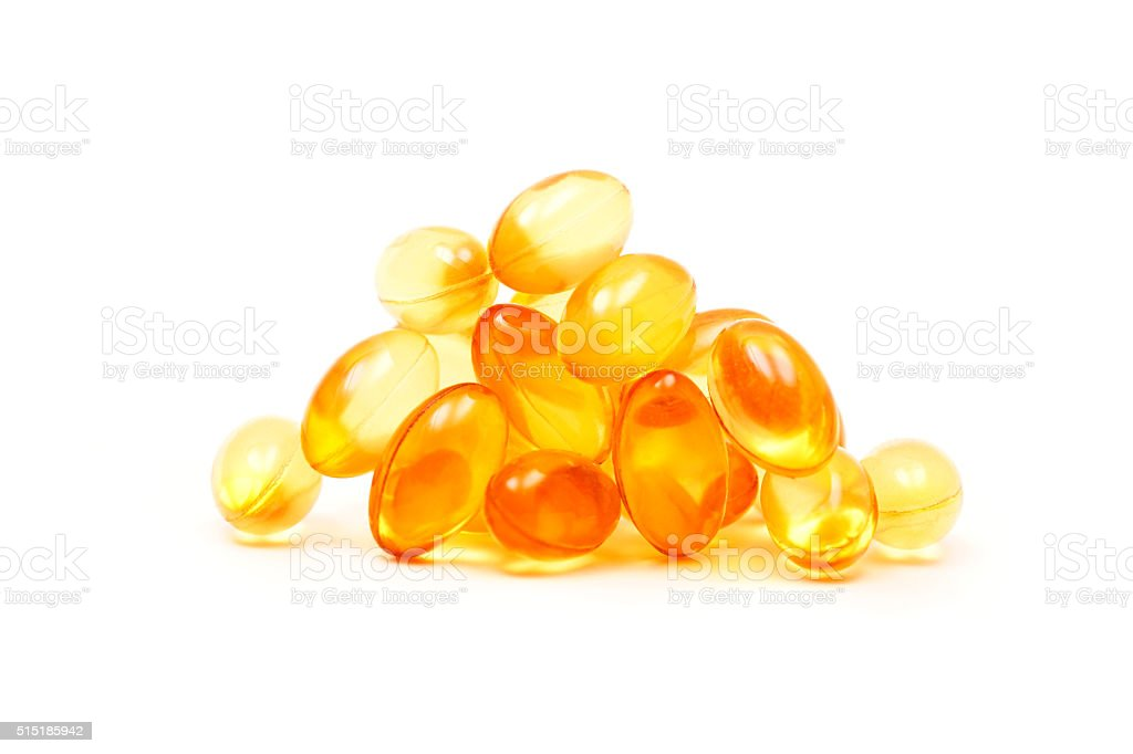 Fish oil capsules (medicine and health products) isolated on white stock photo