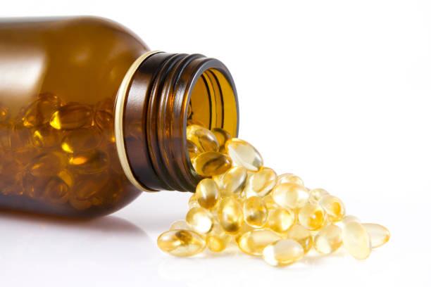 fish oil capsules - vitamin d стоковые фото и изображения