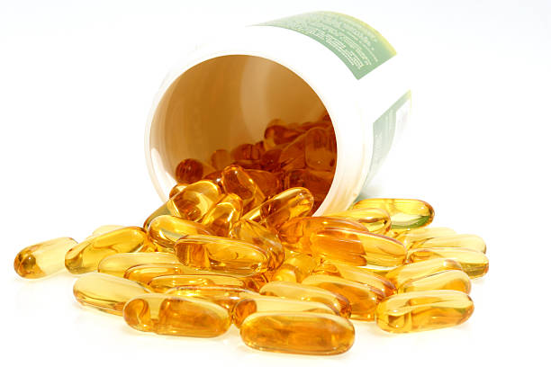 fish oil capsules - cod liver oil stock photos and pictures