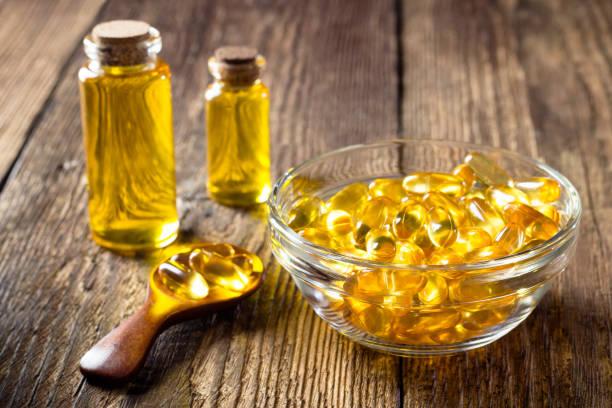 Fish oil capsules stock photo