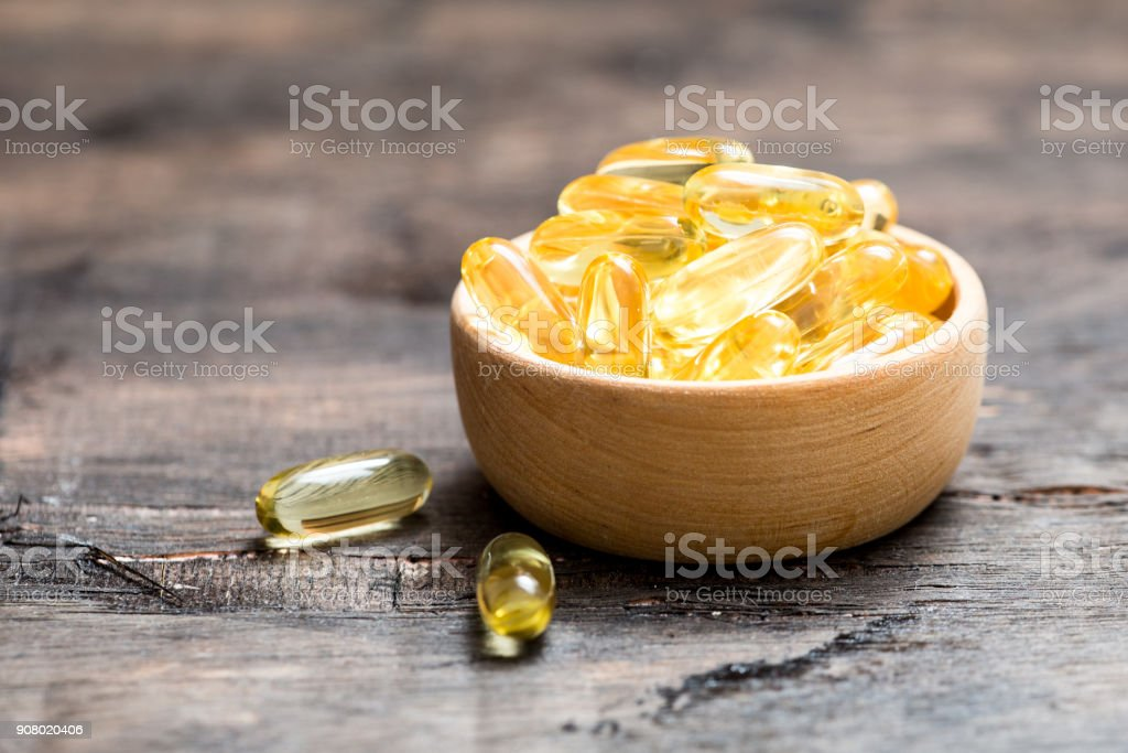 Fish oil capsules with omega 3 and vitamin D. healthy diet concept. stock photo