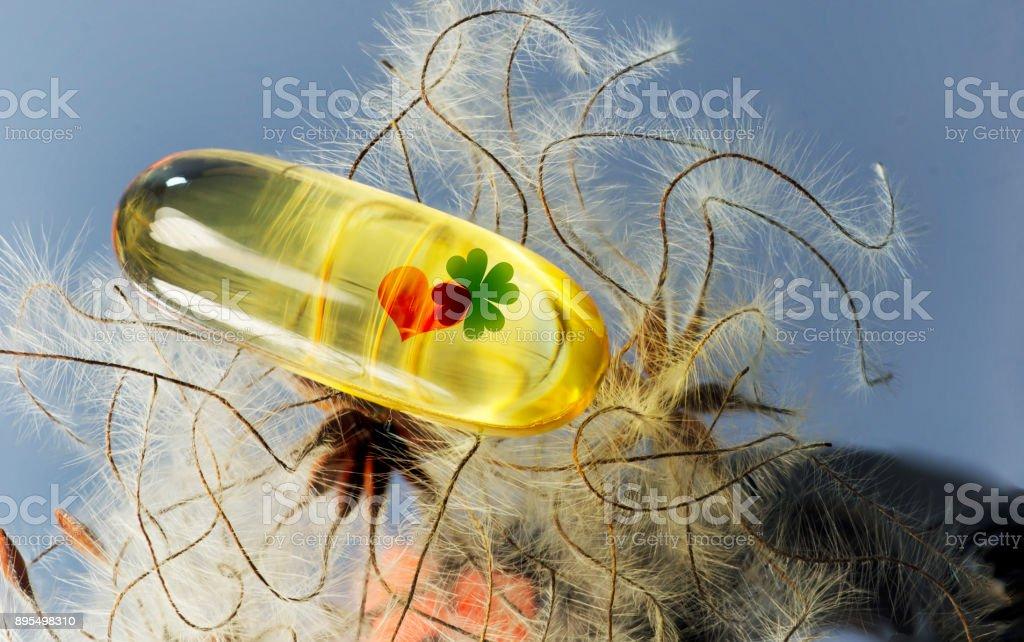 fish oil, heart, clover stock photo
