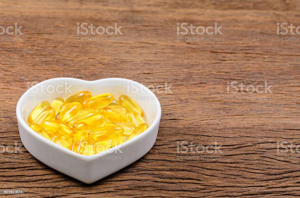 fish oil in heart shape bowl stock photo