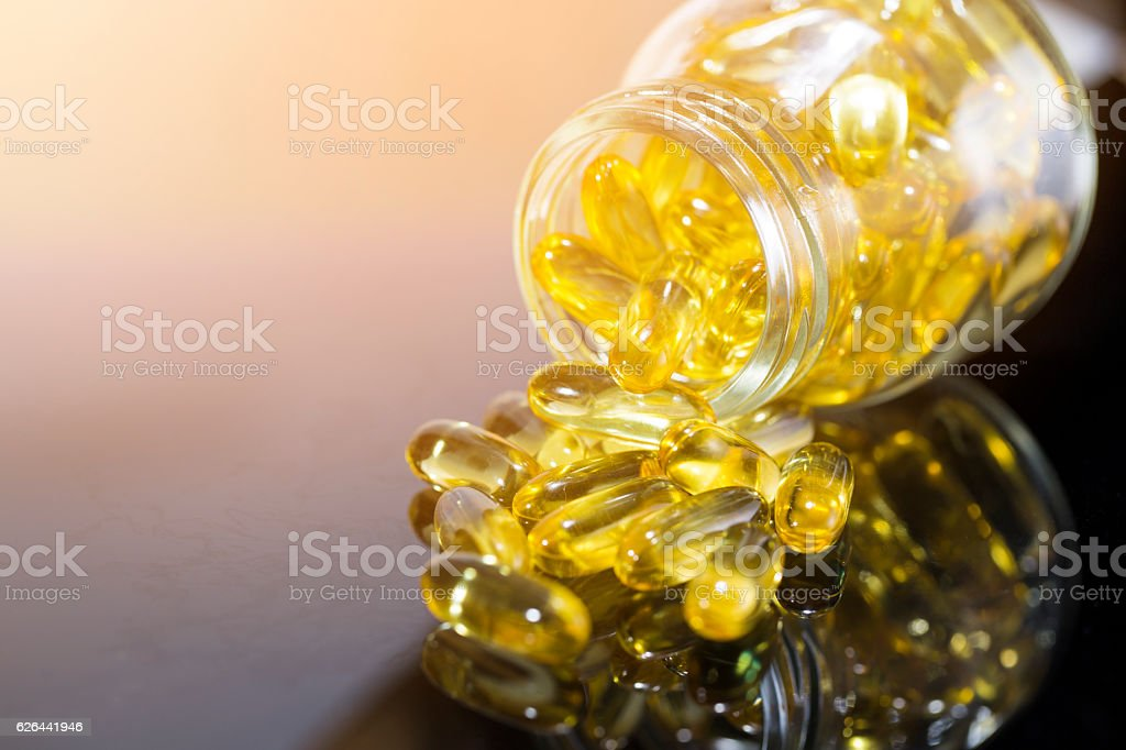 fish oil on the black table with sunlight stock photo