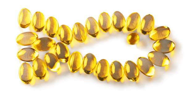 fish oil. - cod liver oil stock photos and pictures