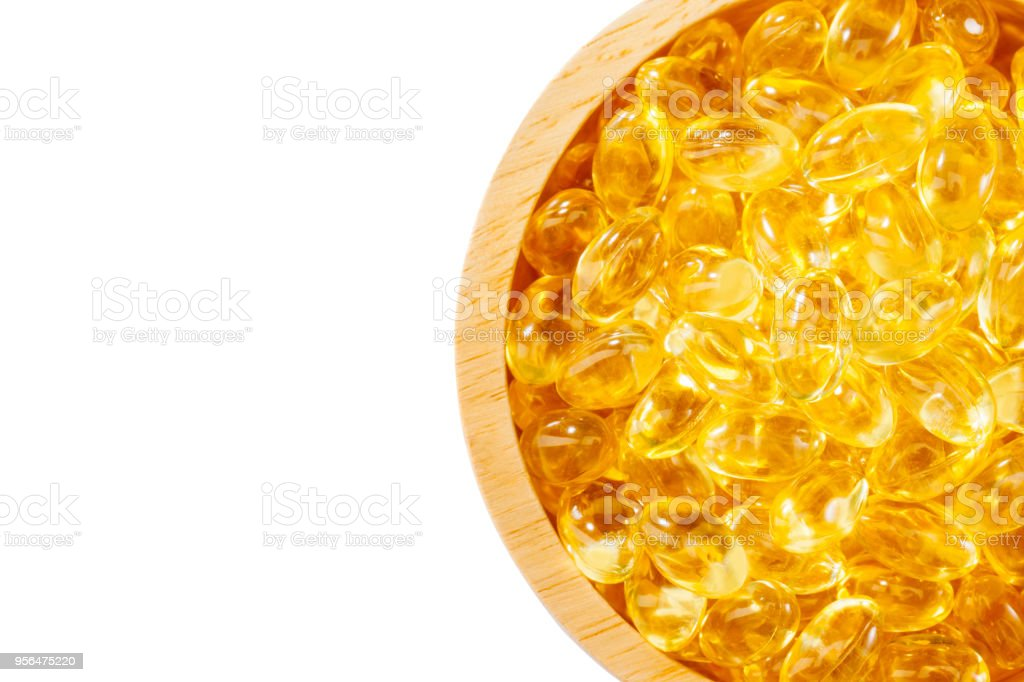 Fish oil, soft capsule, omega, supplement in wood bowl  isolated  on white background with clipping path and copy space ,healthy product concept close up stock photo